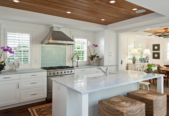 Coastal Kitchen. with reclaimed wood ceiling. Reclaimed wood ceiling in kitchen. The recycled cypress wood are from the old floors of the original house. #kitchen #reclaimedwood #ceiling #recycledcypresswood #cypresswoodceiling MHK Architecture & Planning