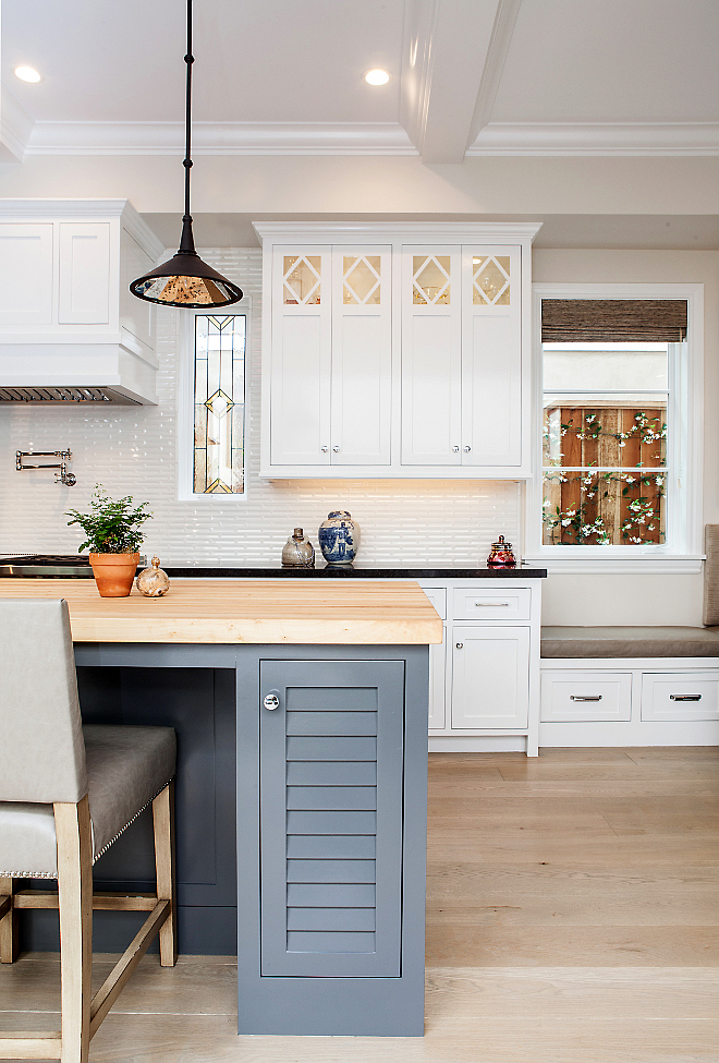 White kitchen with gray island paint color. White kitchen cabinet paint color is Benjamin Moore Decorator's White. Gray island paint color is Benjamin Moore Kendall Charcoal. #WhiteKitchen #PaintColor #BenjaminMooreDecoratorsWhite #Darkgrayisland #BenjaminMooreKendallCharcoal #Kitchen