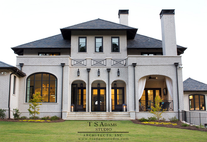 This classic home features brick exterior painted in an ivory white and slate roof. #paintedbrick #brickexterior #slateroof TS Adams Studio Architects. Traci Rhoads Interiors.