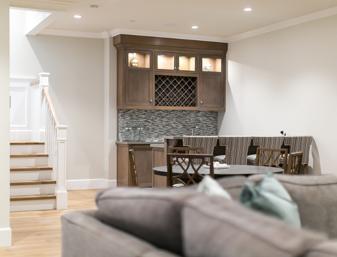Basement Bar. Bar. Basement features bar area in stained white oak, caesarstone countertop and glass backsplash. #Bar #Basement #ideas Churchill Design