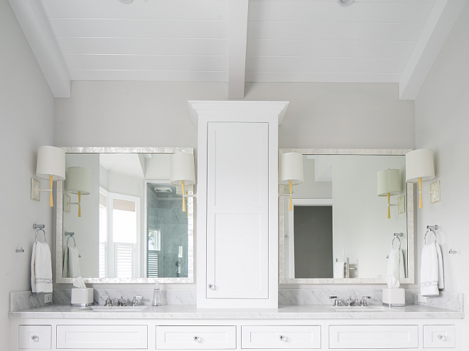 White and grey bathroom. White shaker cabinets are Benjamin Moore Decorator's White. Grey wall paint color is Stonington Gray by Benjamin Moore #white #grey #bathroom #paintcolor #Benjaminmooredecoratorswhite #whitecabinet #greywalls #StoningtonGray #BenjaminMoore