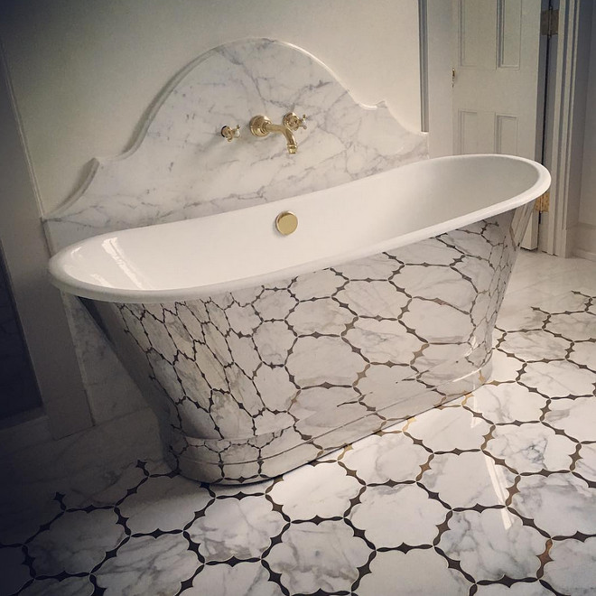 Bathroom Heated floors. Bathroom with heated brass inlayed Calcutta gold marble floors. Melanie Turner Interiors
