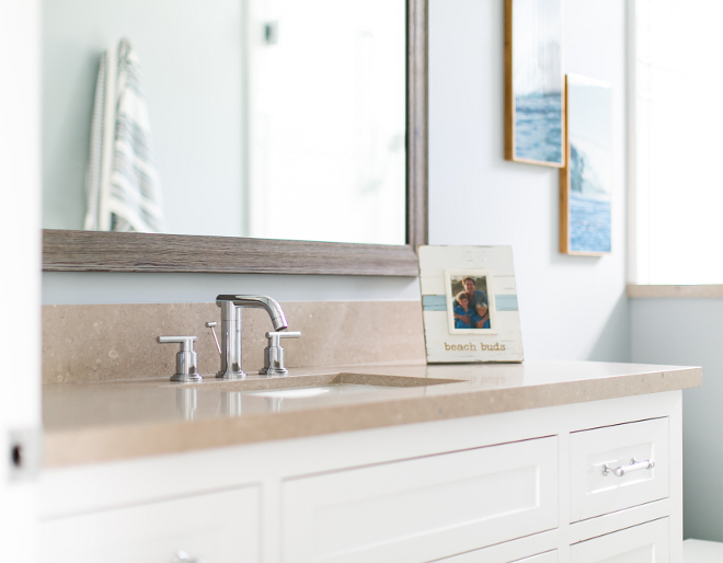 Bathroom Quartz Countertop. Countertop is Caesarstone quartz. The custom mirror is made of reclaimed wood. #bathroom #quartz #caesarstone Churchill Design.