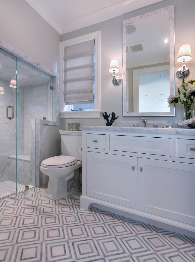 "Bathroom Tiling. Bathroom tiling. Marble tiling bathroom. Bathroom marble tilingg Shower Floor is White Carrar and the tile floors are 3"" white Carrara honed. Wall paint color is Benjamin Moore Moon Shadow. #Marble #bathroom #tiling #tiles #honedtiles Patterson Custom Homes"