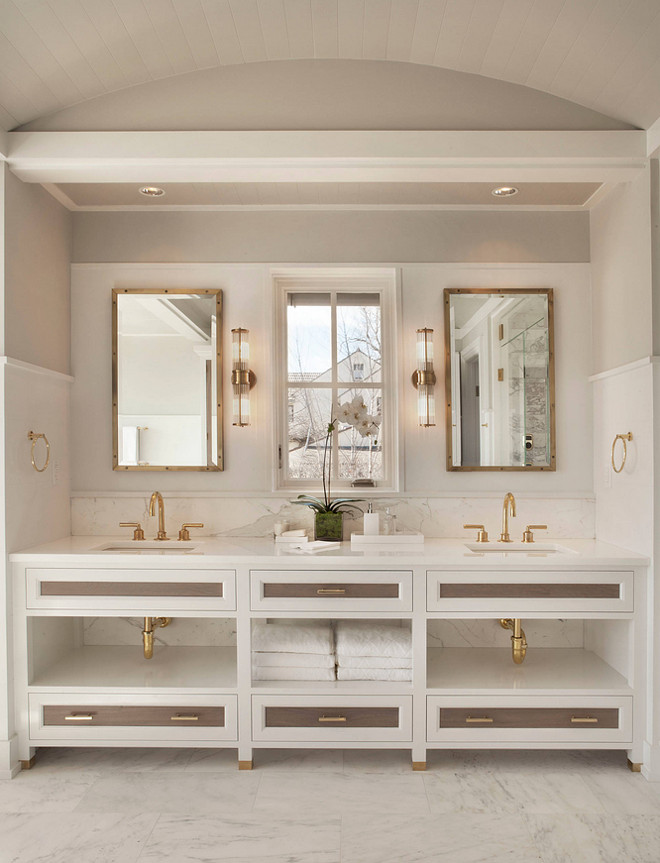 Bathroom Walls and Cabinet Paint Color. The color on the walls above the paneling is Gray Owl with a satin finish by Benjamin Moore. The wainscot is done in Decorator's White with a semi-gloss finish. #Bathroom #Paintcolor #BenjaminMooreGrayOwl #wallpaintcolor #CabinetPaintcolor #BenjaminMooreDecoratorsWhite Michael Greenberg & Associates
