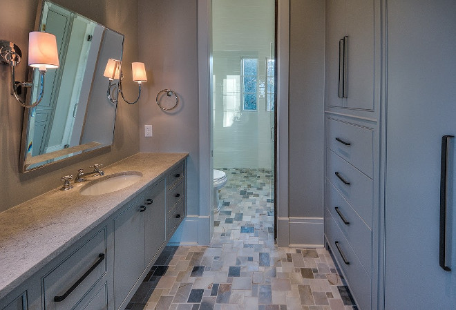 Bathroom cabinets. Bathroom cabinet ideas. Bathroom features a long vanity and a storage cabinet across vanity. #Bathroom #Cabinet #Storage