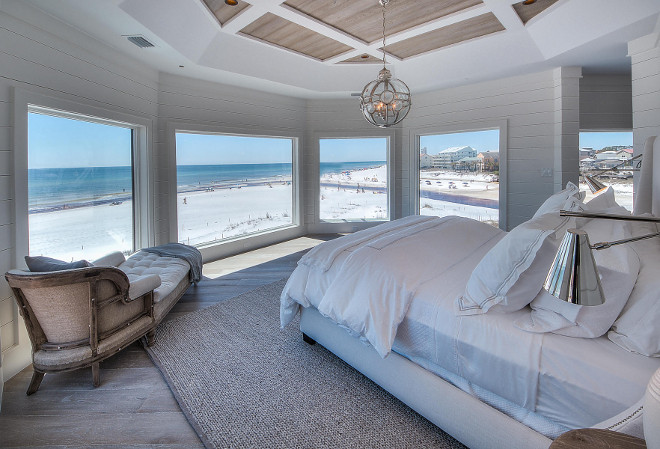 Beach house bedroom. All white bedroom with whitewashed hardwood floors, reclaimed wood ceiling, white shiplap wall paneling. #Bedroom