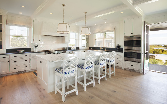 Beach house kitchen. Neutral Beach house kitchen with wide plank floors. Beach house kitchen #NeutralKitchen #Beachhouse #kitchen #Beachhousekitchen #neutralBeachHousekitchen Lynn Morgan Design.