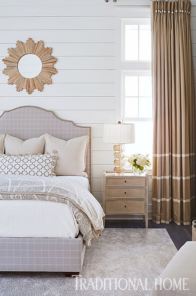 Bedroom. Neutral and monochromatic bedroom. Neutral and monochromatic bedroom ideas. The nailhead-trim headboard creates a sinuous line against the shiplap wall paneling. An Arteriors lamp sits on a nightstand from Gabby. Neutral and monochromatic bedroom design #Neutral #monochromatic #bedroom #interiors