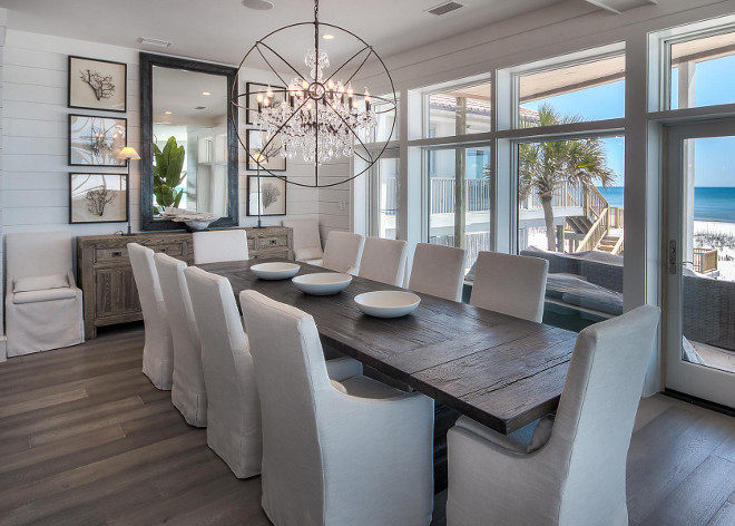 Dining Room. Modern Coastal Dining room with tongue and groove wall paneling, slipcovered linen chairs and wide plank floors. #diningroom #moderndiningroom #moderncoastal #coastalinteriors #tongueandgroove #wallpaneling #wideplank