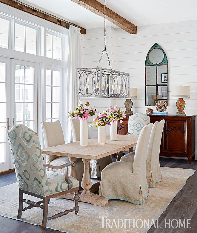 Dining Room. Shiplap dining room walls with reclaimed beams on ceiling. Chandelier is from Beau Home Interiors. #Diningroom #shiplap #walls #reclaimedbeams