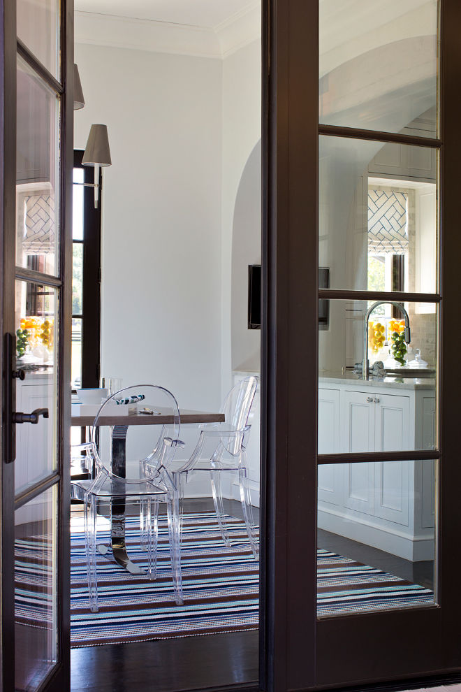 French doors. Kitchen with French doors to patio. French doors open to the patio. Floors are oak with a dark stain. French doors open to a loggia. Floors are oak with a dark stain. TS Adams Studio Architects. Traci Rhoads Interiors.