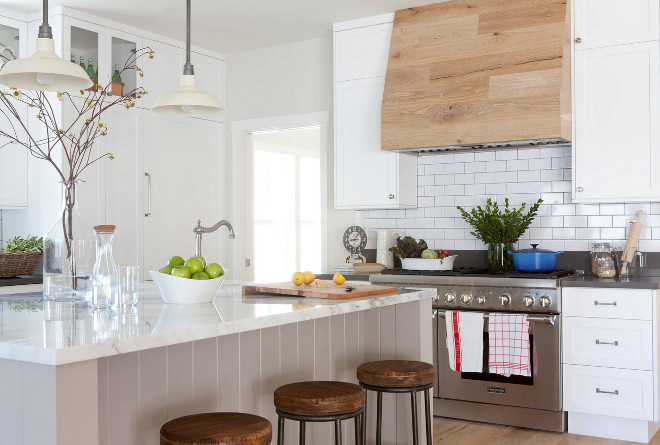 Farmhouse kitchen. Farmhouse kitchen with gray island, white cabinets and reclaimed wood hood. #Farmhousekitchen #kitchen #grayisland #whitecabinets #reclaimedwood #reclaimedwoodhood