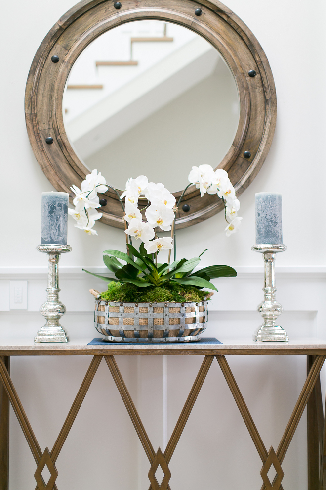 Foyer Console Table and Mirror. Foyer Interiors. I love how Trish Steele from Churchill Design decorates every room without overdoing it. She knows how to balance a space perfectly. #Foyer #consoletable #mirror #interiors #interiordesign #interiordesigner Churchill Design.