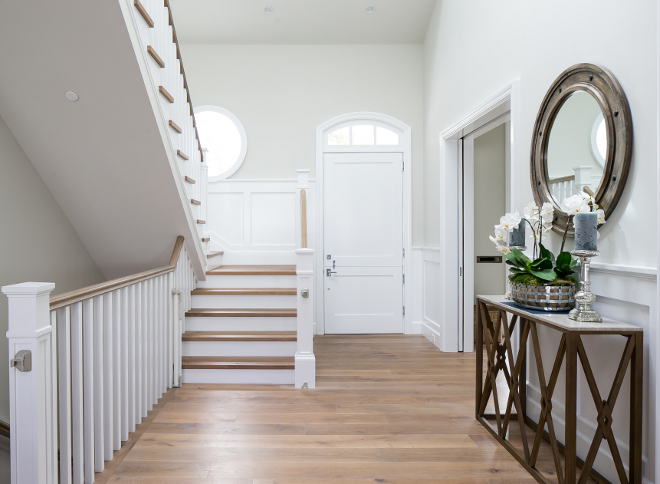 "Foyer Flooring. Foyer waincoting and floors. The custom flooring is white oak 8"" plank. Traditional wall wainscoting - foyer #foyer #flooring #wainscoting #customflooring #whiteoak #plank #traditionalwainscoting Brandon Architects, Inc. Churchill Design."