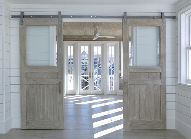 Glass and Wood Barn Door. Barn door with glass and whitewashed reclaimed wood. #BarnDoor #GlassbarnDoor Corestruction