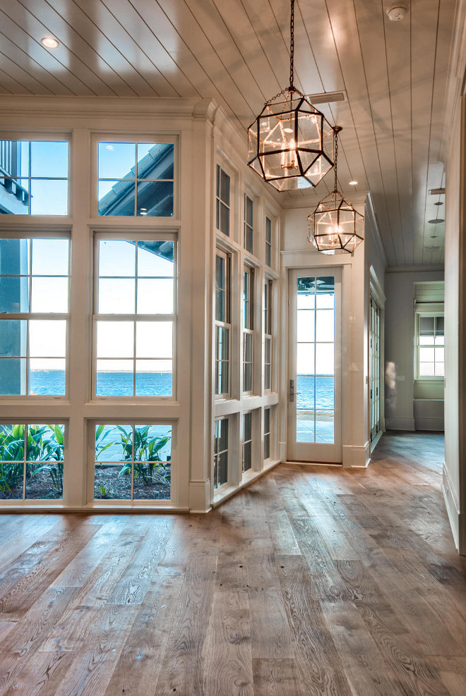 Florida waterfront home for sale home bunch interior for Wooden floor interior design