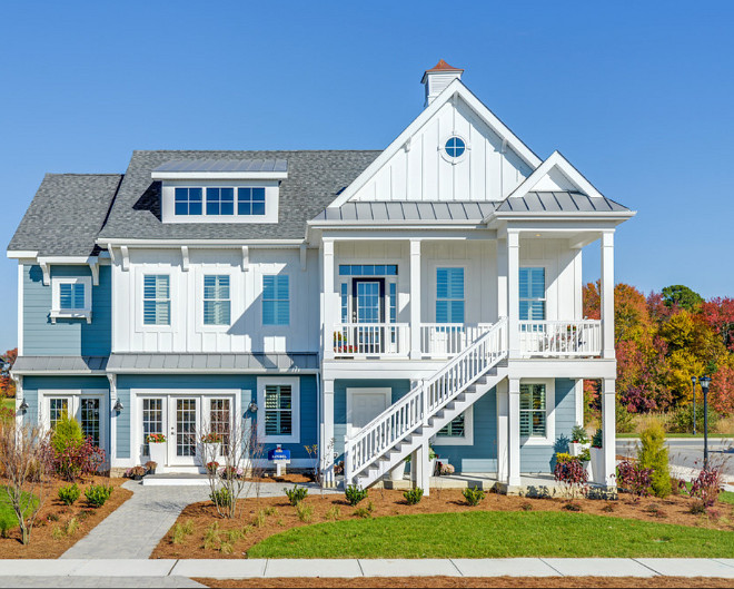 Home Exterior. Blue and white home exterior. Home exterior features blue siding and white board and batten exterior. #Blueexterior #blueandwhiteexterior #siding #boardandbatten Schell Brothers