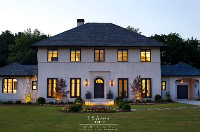 Home Exterior. Home exterior. Classical exterior ideas. Eliptical arch. Exterior lighting. Hipped roof. Exterior painted brick. Portico. Slate roof. stepping stones. Traditional exterior. White exterior #home #exteriors TS Adams Studio Architects. Traci Rhoads Interiors.
