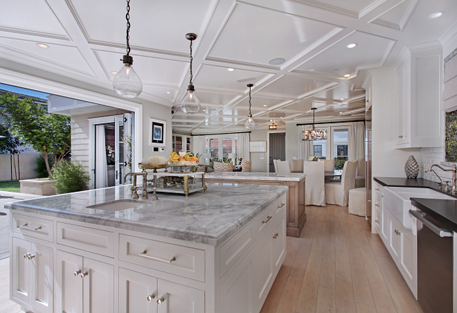 "Island Countertop ideas. Natural Quartz Carrara. Island countertop material and edge details. The countertops are Natural Quartz Carrara, super white polished slab with ogee edge detail and 2 1/4"" apron. #Kitchen #island #marble #edge #countertops #NaturalQuartzCarrara #superwhite #polishedslab #ogeeedge Patterson Custom Homes"