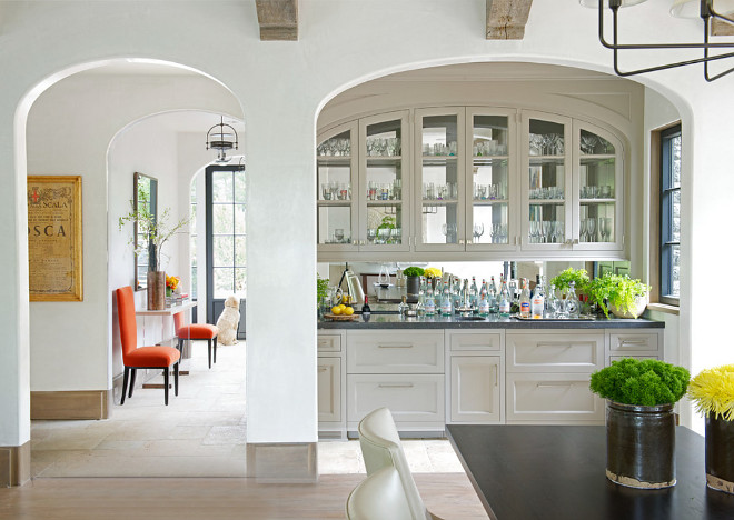 Kitchen Bar Cabinet. A wet bar cabinet is located in an arched nook just off the kitchen. #kitchen #Bar #beveragecabinet #wetbar Brooks and Falotico Associates, Inc.