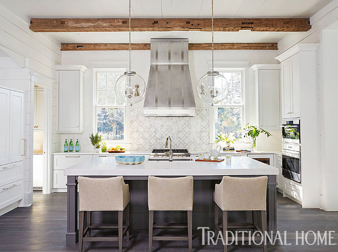 "Kitchen Kitchen. A custom hood is centered on a waterjet-cut marble-and-glass tile backsplash. Glass orb pendants were custom-designed for above the island. Kitchen Pendants: ""Vintage Glass Bubble Light"" from South of Market. #kitchen #kitchens"
