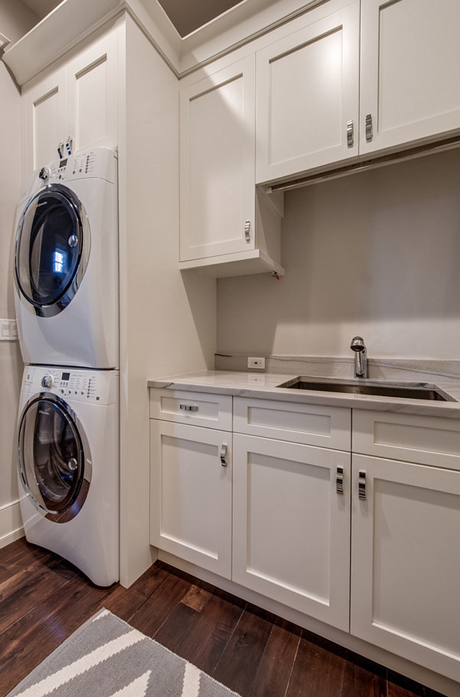 Laundry room white cabinets paint color. Laundry room white cabinet paint color is Sherwin Williams SW 6385 Dover White. Laundry Room gray wall paint color is Sherwin Williams Agreeable Gray