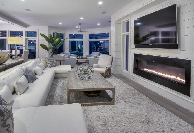 """Living room fireplace. The living room is anchored by a 72"""" fire- spark fireplace and 75"""" television. #livingroom #fireplace #tvabovefireplace"""