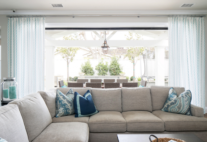 Living room with open doors to patio. Sectional is by Churchill Design. Churchill Design.