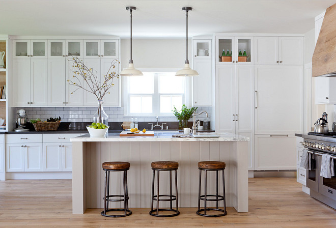 "Modern Farmhouse kitchen. The shaker style cabinetry was made in walnut, and painted in Benjamin Moore's ""Decorators White"". This is one of the designer's favorite whites because it reflects the natural light so beautifully and looks really fresh in a kitchen. Modern white Farmhouse kitchen. Modern Farmhouse kitchen with white cabinets. #ModernFarmhouse #FarmhouseKitchen #Whitefarmhousekitchen Kate Lester Interiors"