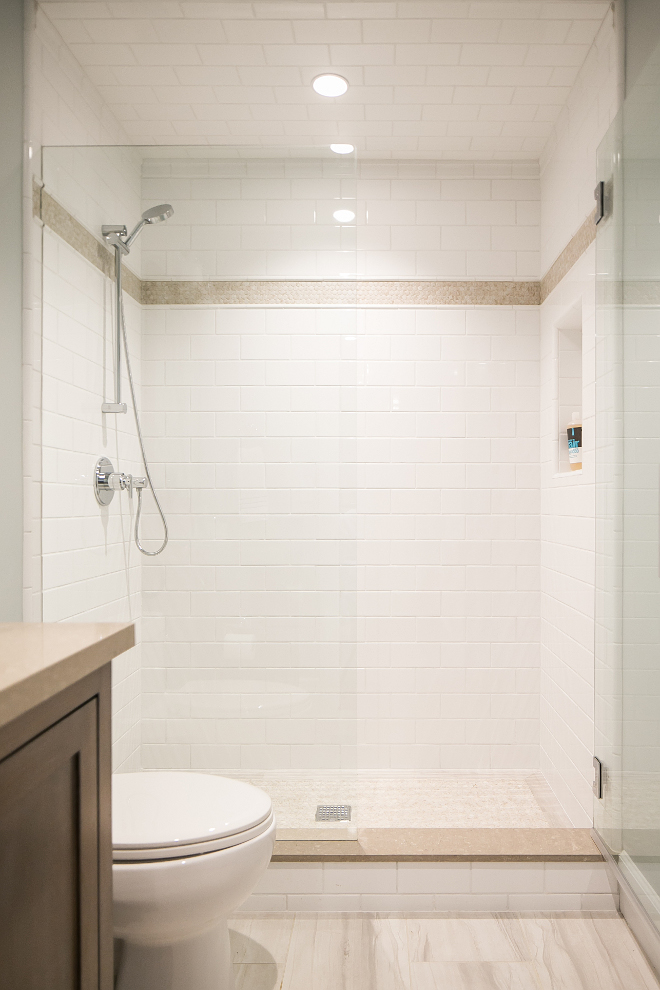Neutral Bathroom Tiling Combination. Bathroom feature off-white subway tiles, neutral floor tiles and neutral quartz countertop. Churchill Design