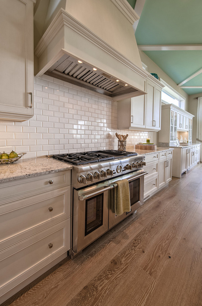 Off white kitchen cabinet with wire brushed white oak flooring and Robin Egg Blue ceiling paint color. #offwhite #kitchen #wirebrushedfloor #whiteoak #flooring #RobinEggBlue