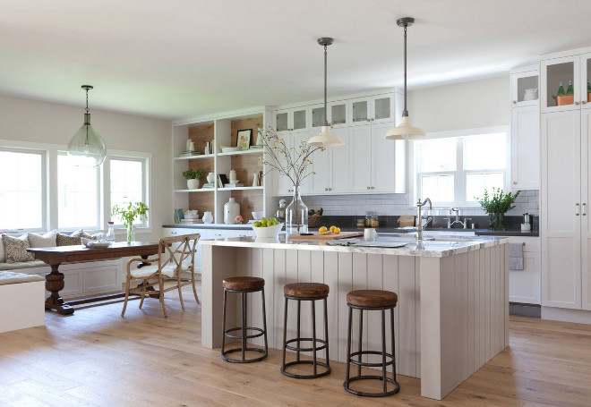 "Modern Farmhouse Kitchen. The overall concept for the home is ""Modern Farmhouse"" and the designer's goal was to capture the charm, texture, and classic feel of a traditional farmhouse and incorporate that in to a more modern floor plan and design concept. In this modern farmhouse kitchen, the designer's most favorite element is the wood paneled hood. It took a little convincing on her part to get the homeowner to see her vision, but I think we all can agree that it was well worth it. Take a look and take notes on the designer's insights and tips on how to design a neutral modern farmhouse kitchen."