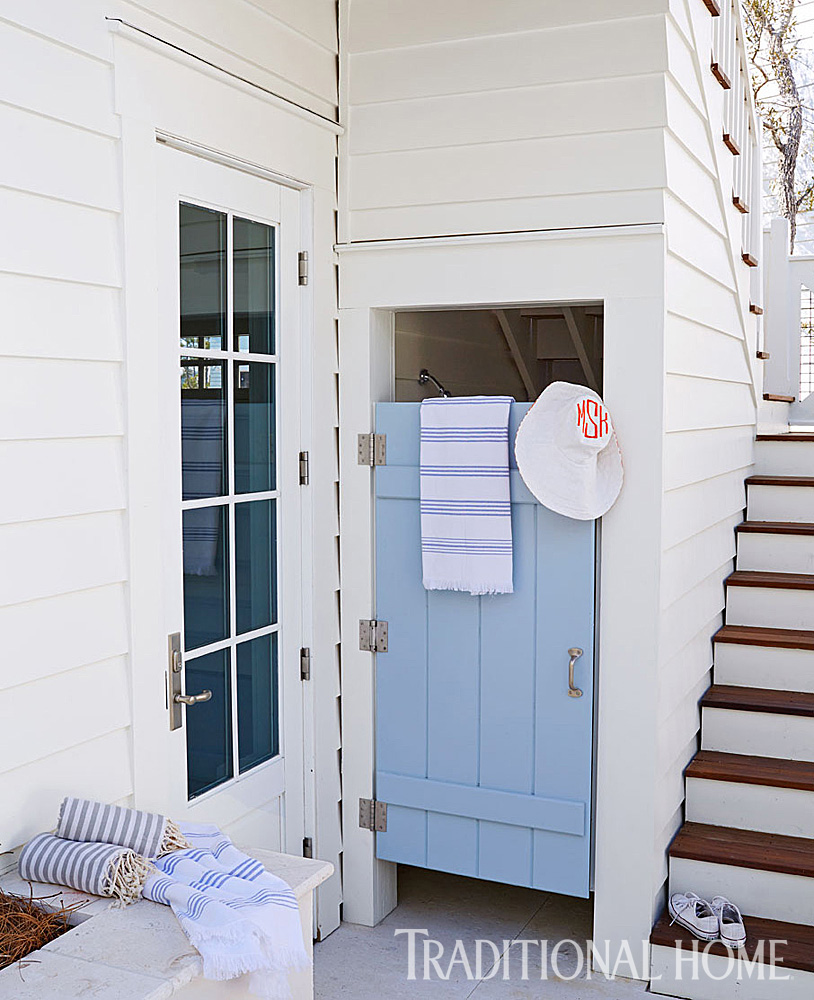 Outdoor Shower. Behind a blue door, an outdoor shower is tucked under the stairway. #Outdoorshower #beachhouse