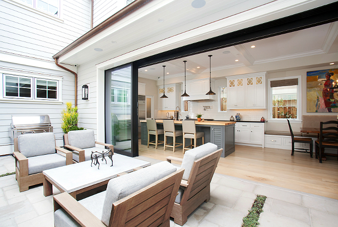 "Patio Sliding Doors. The sliding glass doors made by Western Windows and Doors bring the outdoors in, creating on cohesive space that's perfect for entertaining! Each of the four panels on the sliding tract are 108"" in height. #PatioDoors #SlidingDoors #Doorpanels Patterson Custom Homes"