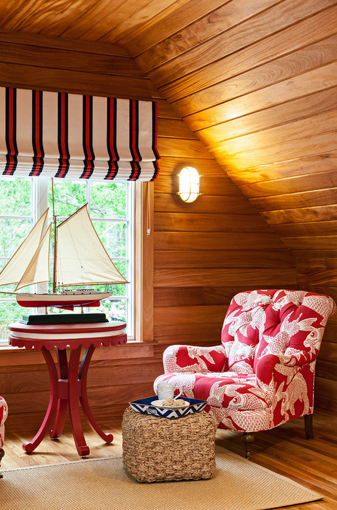 Reading Nook. Nautical theme reading nook with shiplap plank walls. Reading Nook. Chair fabric: Manuel Canovas. Nautical sconces: Visual Comfort. Roman shade fabric: Ralph Lauren. Side table is from Oomph. #ReadingNook #NauticalTheme #Shiplap #plank #Shiplapwalls #plankwalls Violandi + Warner Interiors