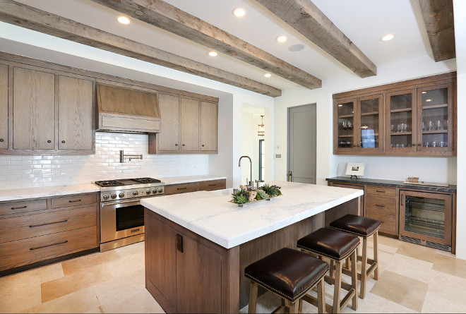 Rustic modern kitchen with white oak cabinets and reclaimed wood ceiling. #Rustic #Kitchen #ModernRusticInteriors #RusticInteriors #kitchens Blackband Design. Graystone Custom Builders