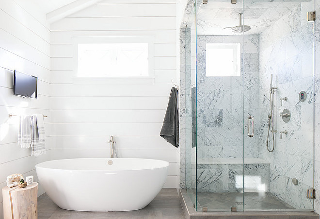 Shiplap bathroom. Minimalist shiplap bathroom with oval tub and marble shower with bench and rain shower. #bathroom #shiplap #minimalist #marble #shower Elizabeth Brooke Design. Photo by Ryan Garvin.
