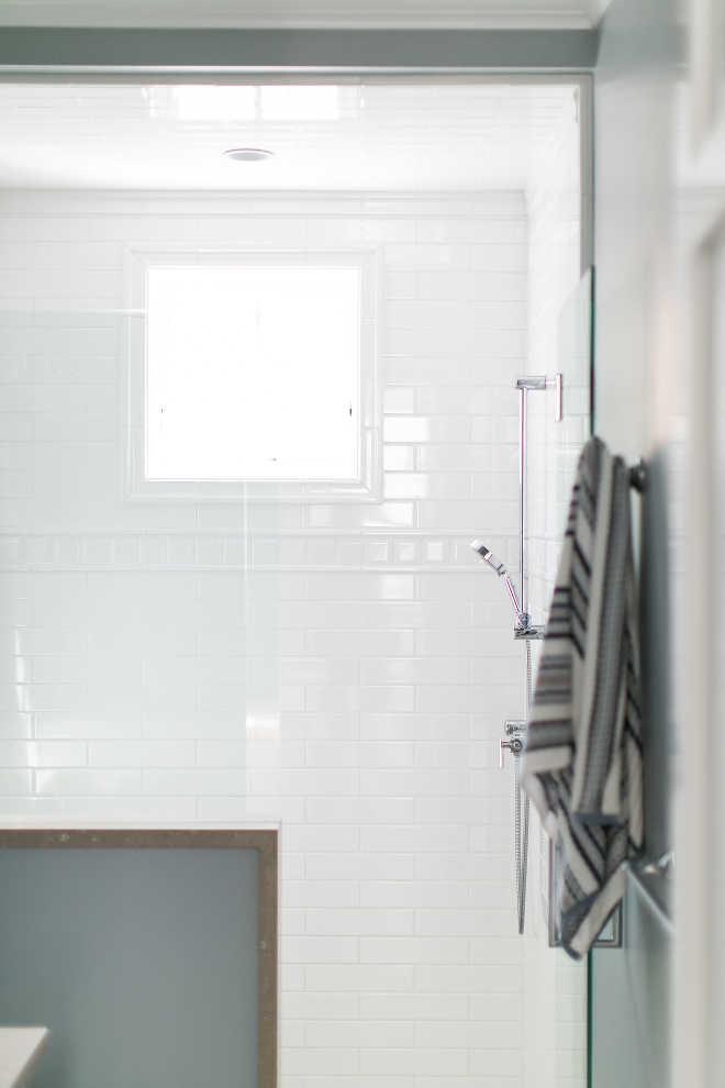 Shower tiles. The shower features only white tiles with different patterns. Great idea! #shower #tiles #whiteshower Churchill Design
