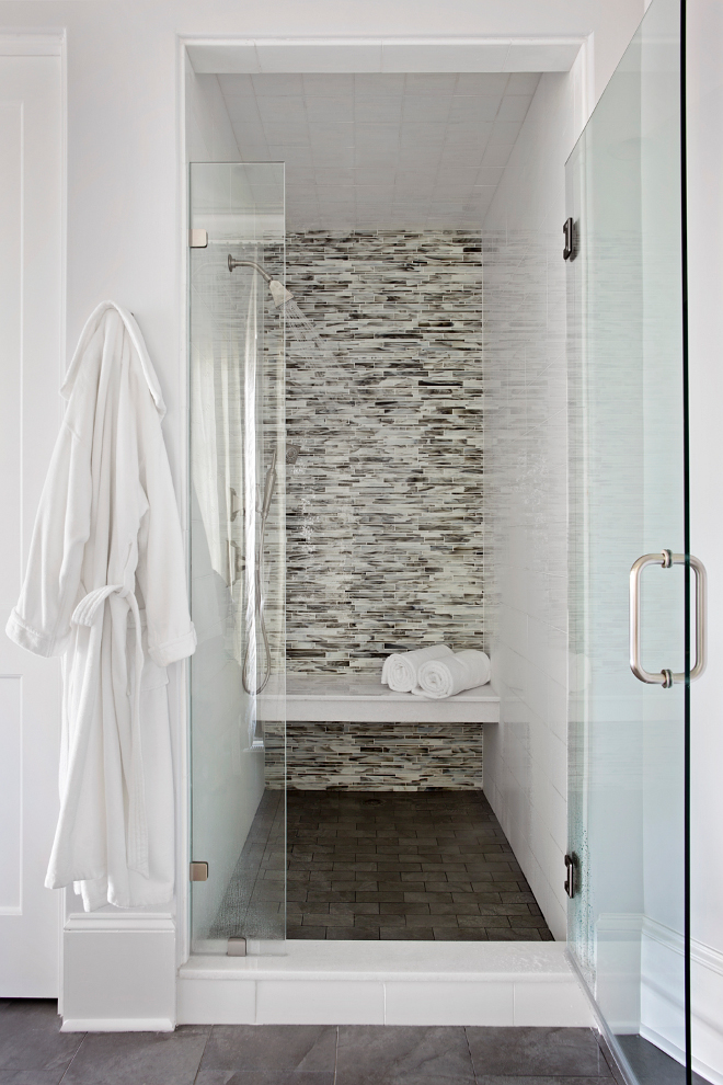 Shower Tiling. Shower Tiling ideas. This luxurious walk-in shower features linear mosaic glass tile shower surround and floating shower bench over dark gray tile floor. #Shower #Tiling #ShowerTiling #Tiles #tile TS Adams Studio Architects. Traci Rhoads Interiors.