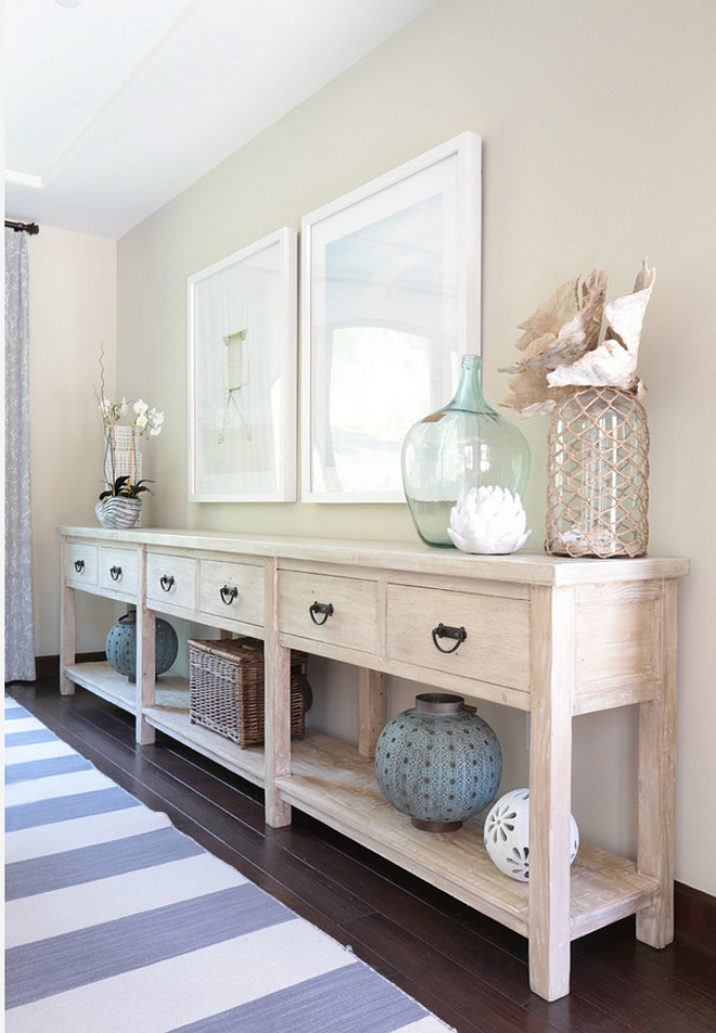 Sideboard. Long sideboard. Dining room features long sideboard with whitewash finish and coastal decor. #sideboard #longsideboard #whitewash Blackband Design