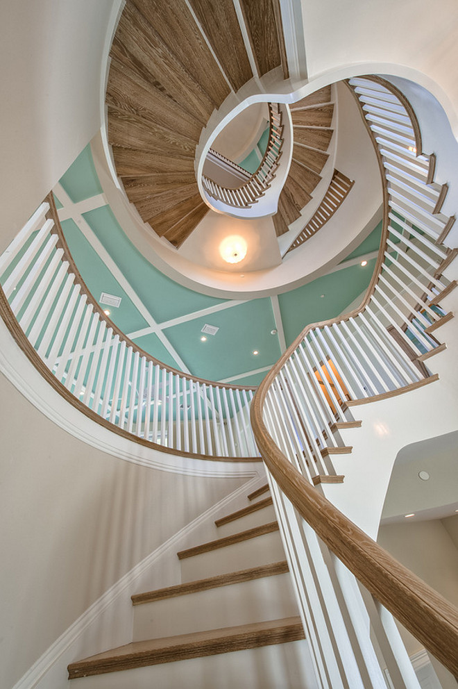 Staircase Millwork. The central staircase is the focal point of this home. Ceiling paint color is Sherwin Williams Aloe and wall paint color is Sherwin Williams SW7555 Patience. #Staircase