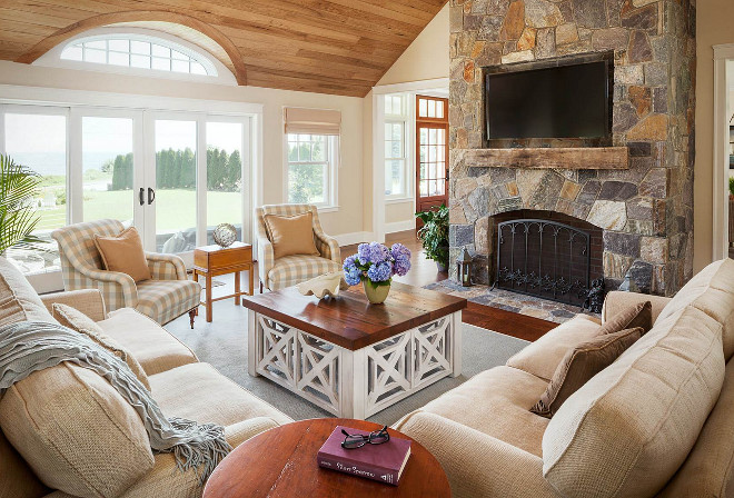 Stone fireplace in neutral living room with wood plank ceiling. #livingroom #Stonefireplace #wood #plank #ceiling #Plankceiling Bowley Builders