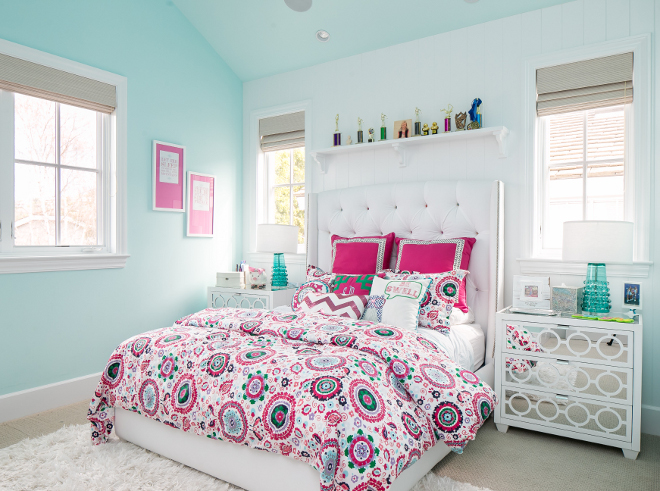 Turquoise and pink bedroom. This bedroom is too darling, isn't it?! The upholstered bed is custom. Bedding is by Eastern Accents. Rug by Feizy. Nightstands are from Worlds Away. Churchill Design.