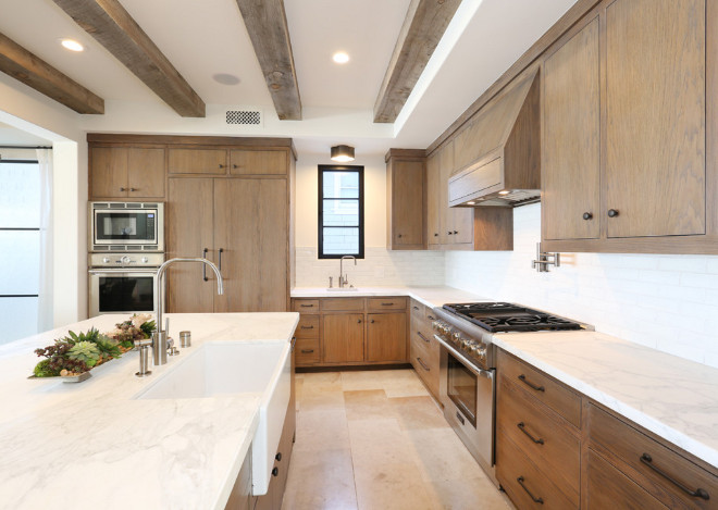 White oak kitchen cabinets White oak kitchen cabinets and marble countertop to contrast with the wood cabinets. #Whiteoak #kitchencabinets . Blackband Design. Graystone Custom Builders