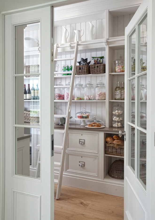Kitchen pantry ladder. Kitchen Pantry. Kitchen Pantry Ideas. This has to be one of the most beautiful pantries out there! The pantry features drawers with open shelving above quartz countertop with tongue and grooved panelling. Notice the stunning ladder and rail. #kitchenPantry #pantry #kitchen #pantry #ladder Hayburn & Co.
