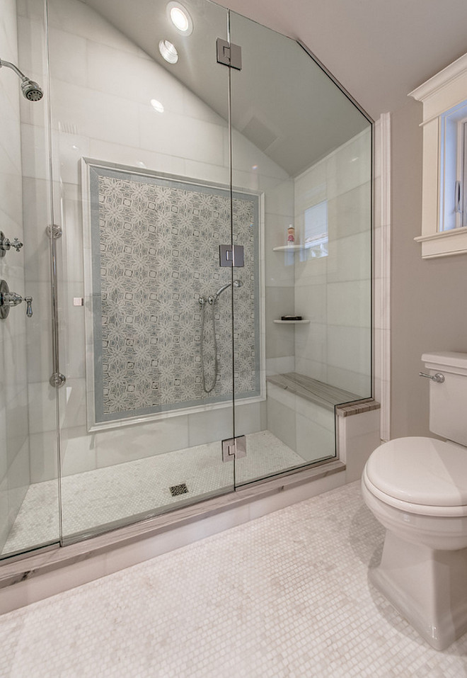 Shower Accent Tile. Walk in Shower features gray geometric accent tiles over a shower bench. Walk in Shower. Gray geometric accent tile. Shower bench. #Walkin #Shower #Graygeometricaccenttile #accenttile #Geometrictile #Showerbench