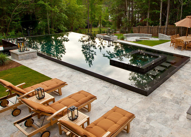 Pool. Pool and spa integrated. Pool Tiles Pool uses German Porcelain Tile that is buff-able, and it is grey. Side tile of the pool is silver travertine. Pool dimensions is 18 x 36. Selective Designs by Shane LeBlanc.