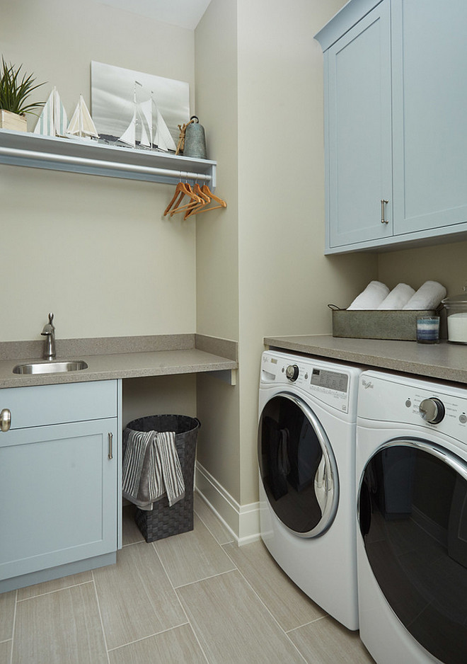 Blue gray cabinet paint color is Benjamin Moore Blue Springs. Benjamin Moore Blue Springs is a great blue gray paint color for cabinets, like the ones we see in this laundry room. Benjamin Moore Blue Springs. #BenjaminMooreBlueSprings