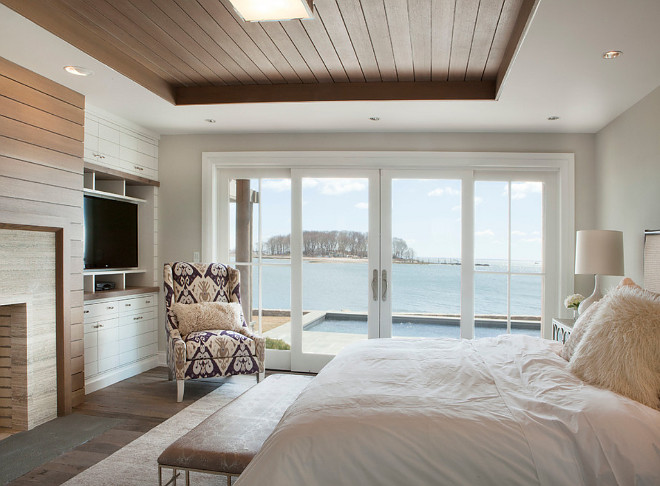 Bedroom shiplap tray ceiling. Bedroom features shiplap tray ceiling and fireplace with shiplap paneling as well. #Bedroom #shiplap #Shiplapceiling #trayceiling #shiplapfireplace Michael Greenberg & Associates.